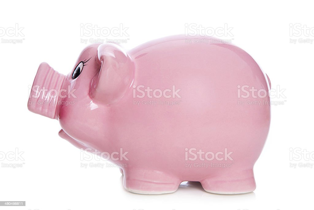 Side elevation of isolated pink piggy bank on white background. royalty-free stock photo