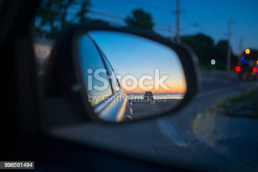 144334852 istock photo Side mirror of the car. View from the window 996591494
