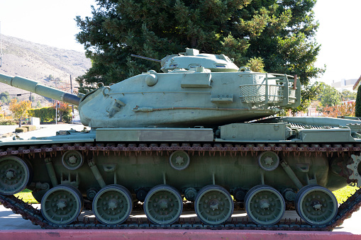 Side of retired military war tank.