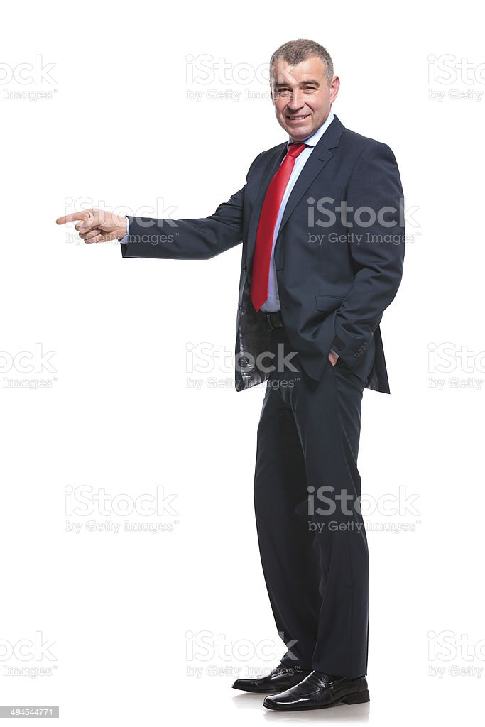 side of business man pointing stock photo
