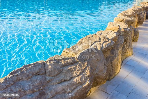 istock side of pool is edged with stone 884495034