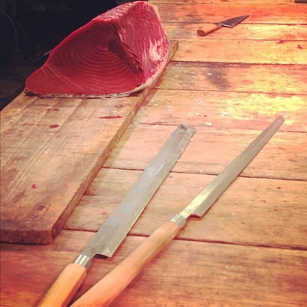 Side of Tuna with Large Knives at Tsukiji Market stock photo
