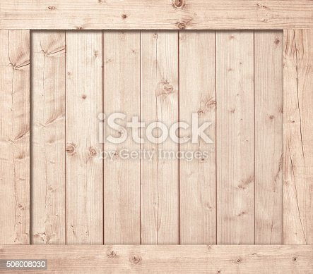 Side of wooden box, wall or frame.