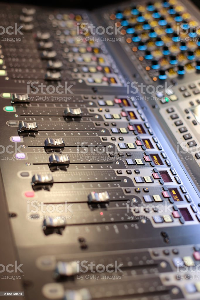 Side photo of the sliders of stage controller stock photo