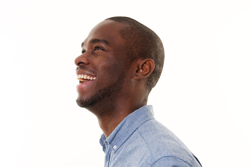 Close up side portrait of laughing african american man looking up