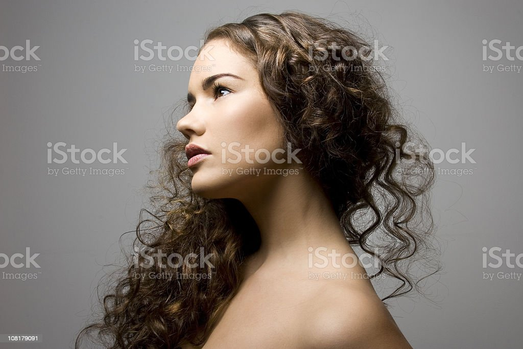 Side Portrait of Young Woman with Curly Hair royalty-free stock photo