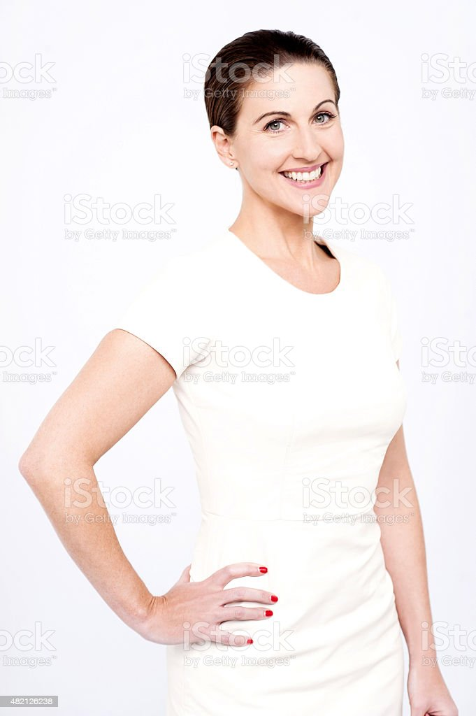Side pose of middle aged woman. stock photo