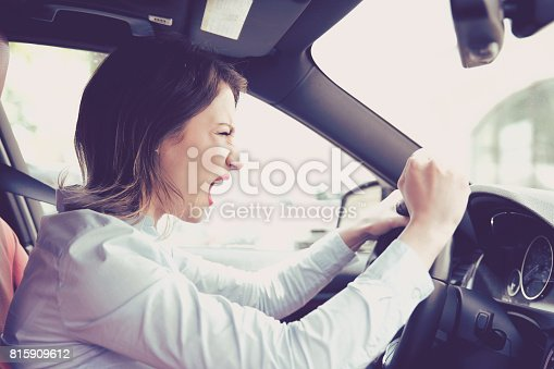 istock Side profile angry female driver. Negative human emotions face expression 815909612