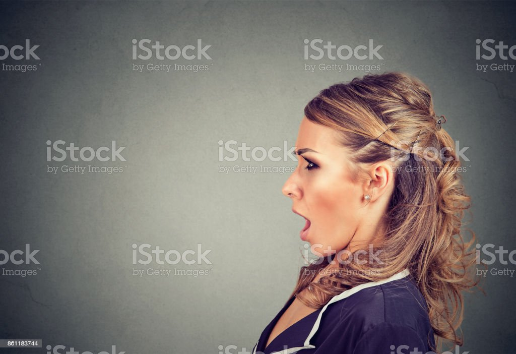 Side profile of a shocked young woman stock photo