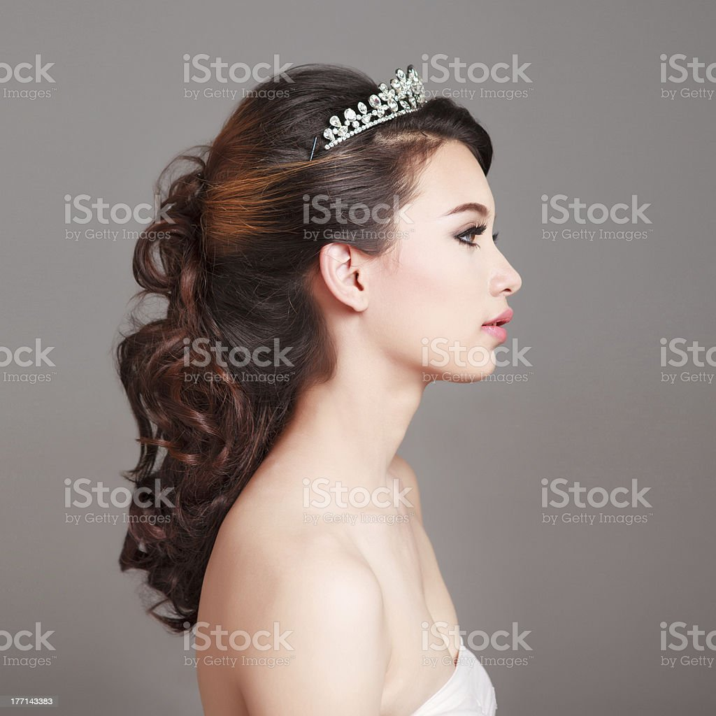 Side Profile Of A Woman In Bridal Makeup And Hairstyle Stock Photo