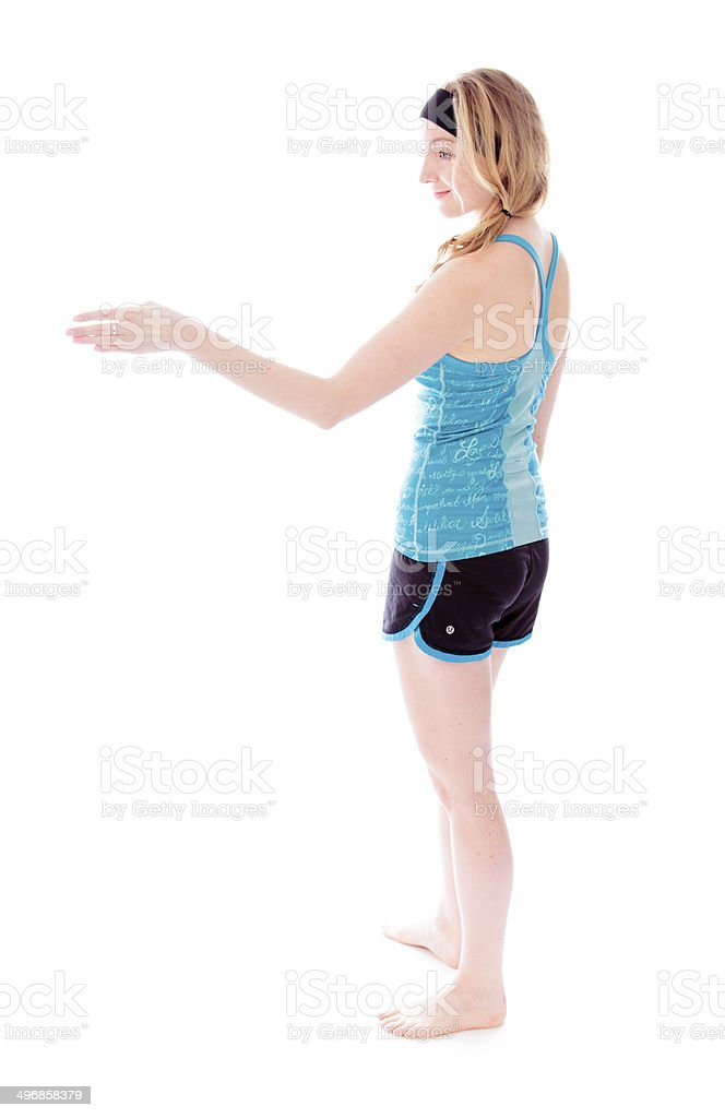 Side profile of a young woman offering hand for handshake stock photo