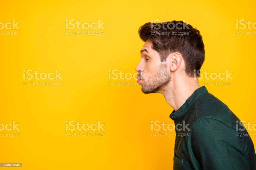 Side profile photo of tender man full of feelings pouting his lips to kiss empty space next to him with eyes closed in a fit of imaginary dreams isolated vibrant color background - Royalty-free Adult Stock Photo