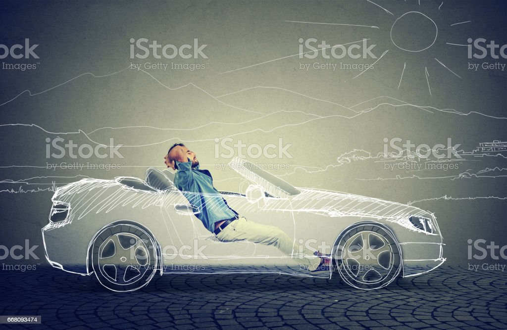 Side profile young business man relaxes in his driverless car stock photo