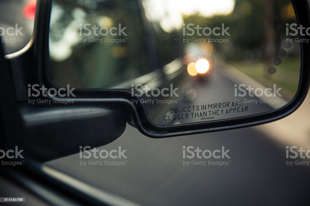 Side rear view mirror of a car stock photo