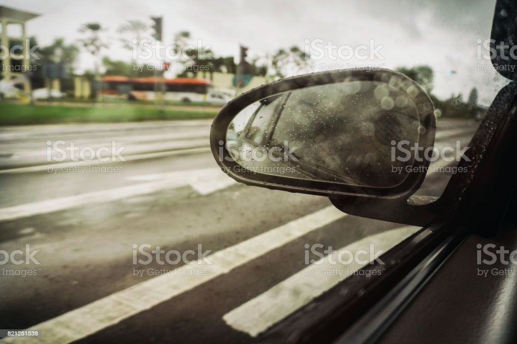 Side Rear View Mirror on Cloudy Day stock photo