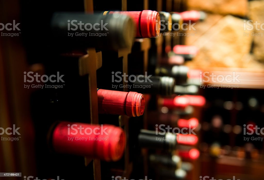Side shot of bottles of wine kept in a wine cellar stock photo