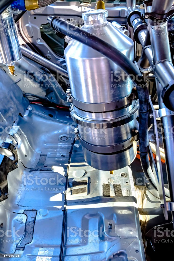 Side shot of nitrous oxide in the back of a stripped rally car stock photo