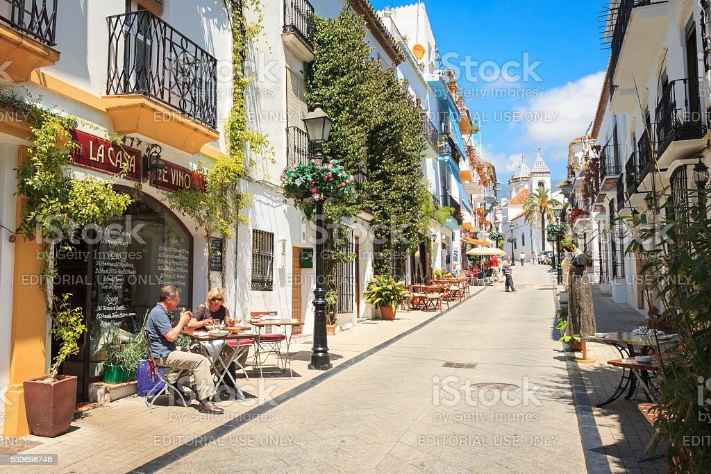 Side street in Marbella Old Town with bars and restaurants stock photo