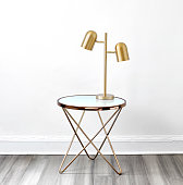 Side table with brass lamp in a living room