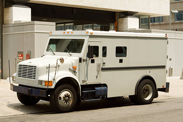 Side View Armoured Armored Car Parked on Street Outside Building stock photo