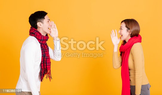 istock side view asian young couple  shouting 1190385164