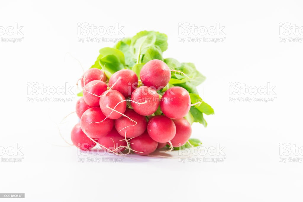 side view Bunch of fresh small red purple radishes on isolated white background stock photo