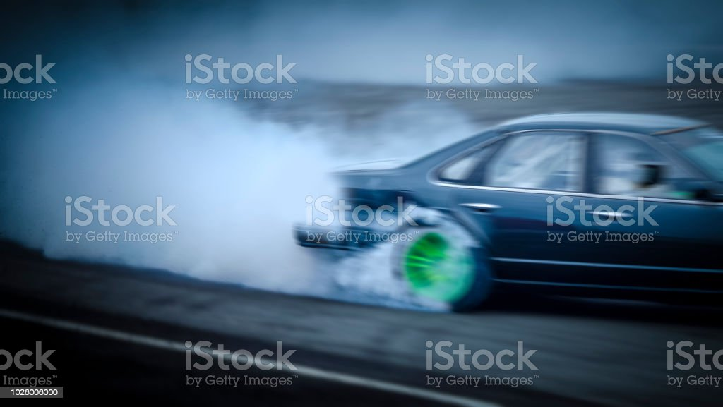 Side View Car Drifting On Track With Grain Sport Car Wheel Drifting And  Smoking On Track Stock Photo & More Pictures of Black Color