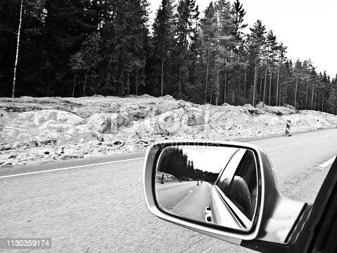 144334852 istock photo Side view mirror and Road markings on an empty motorway 1130359174
