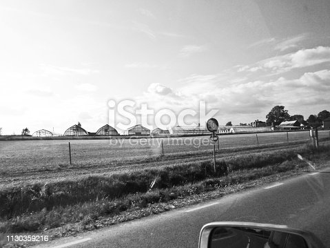 144334852 istock photo Side view mirror and Road markings on an empty motorway 1130359216