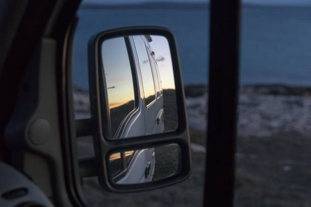 Side view mirror with sunrise stock photo