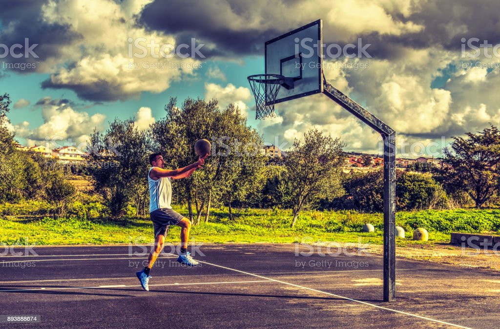 Side view of a basketball player lay up stock photo