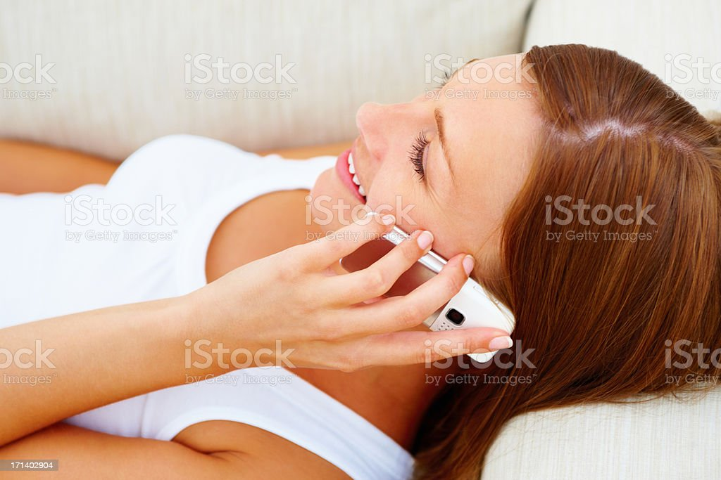 Side view of a beautiful girl talking on cellphone stock photo