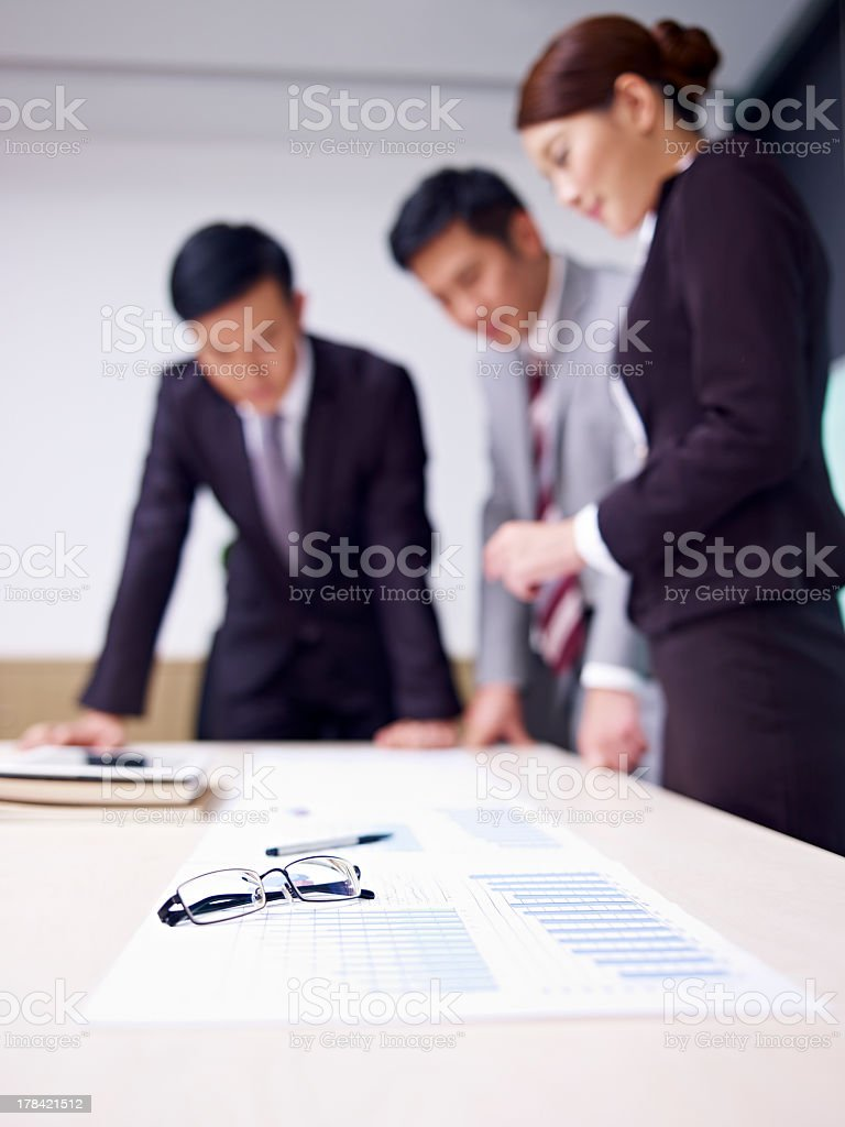 A side view of a business team reviewing items  stock photo