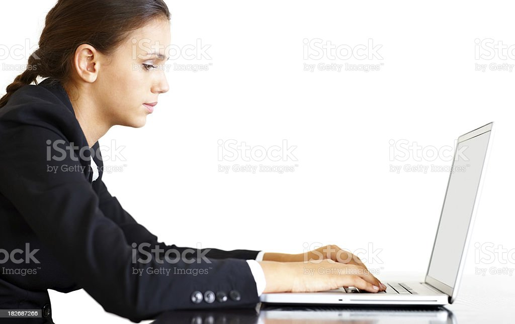 Side view of a business woman working on laptop royalty-free stock photo