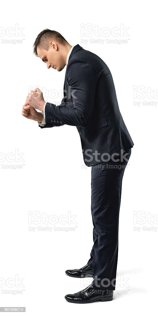 Side view of a businessman carrying invisible sack, isolated on stock photo