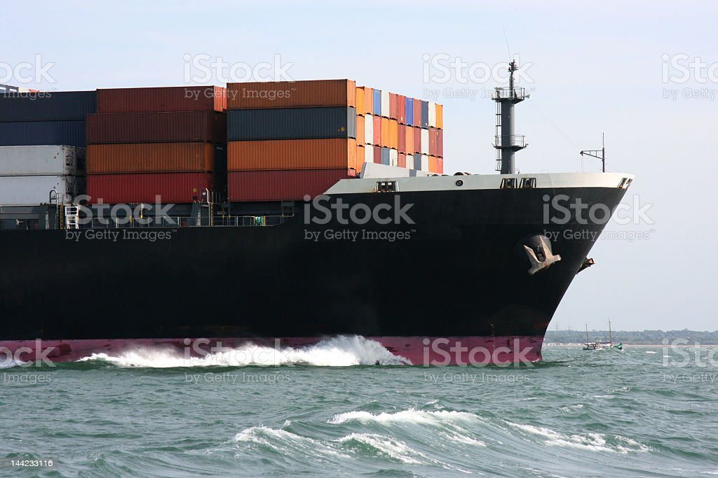 Side view of a cargo ship on the water stock photo