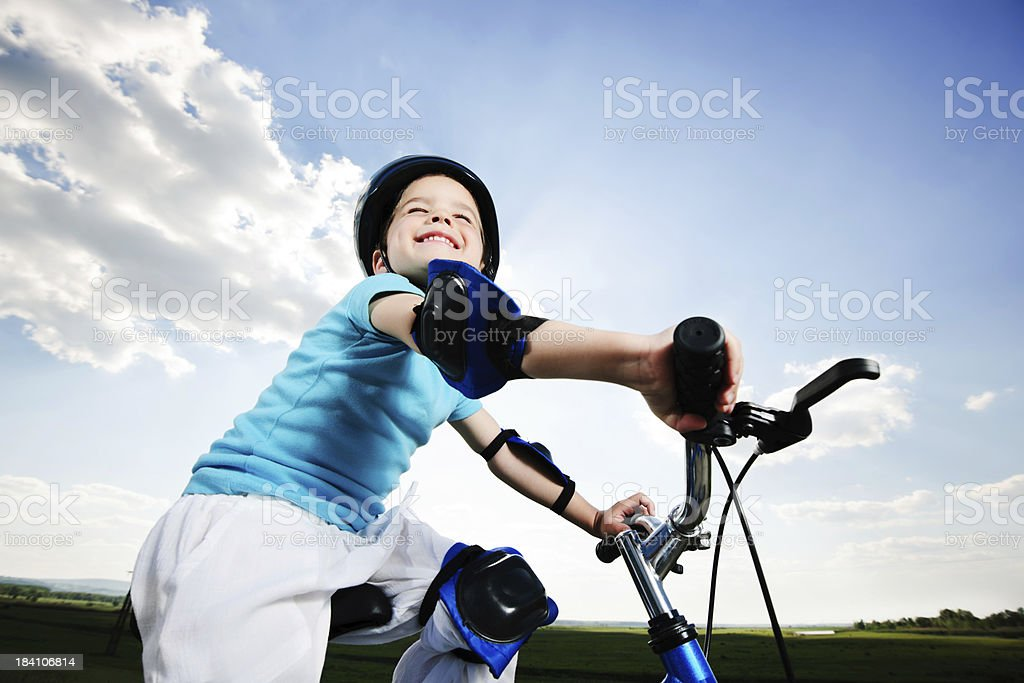 Side view of a cute boy riding the bike. royalty-free stock photo
