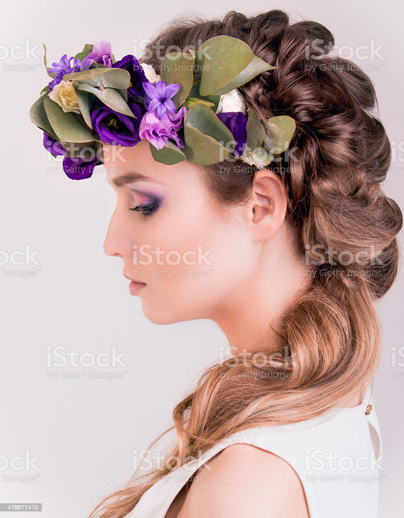 Side view of a girl with flower crown posing in stock photo