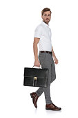 istock side view of a intrigued  man walking with his suitcase 1131987717