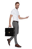 istock side view of a laughing  man with suitcase and welcoming 1131990205