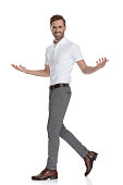 istock side view of a laughing smart casual man  welcoming 1131988619