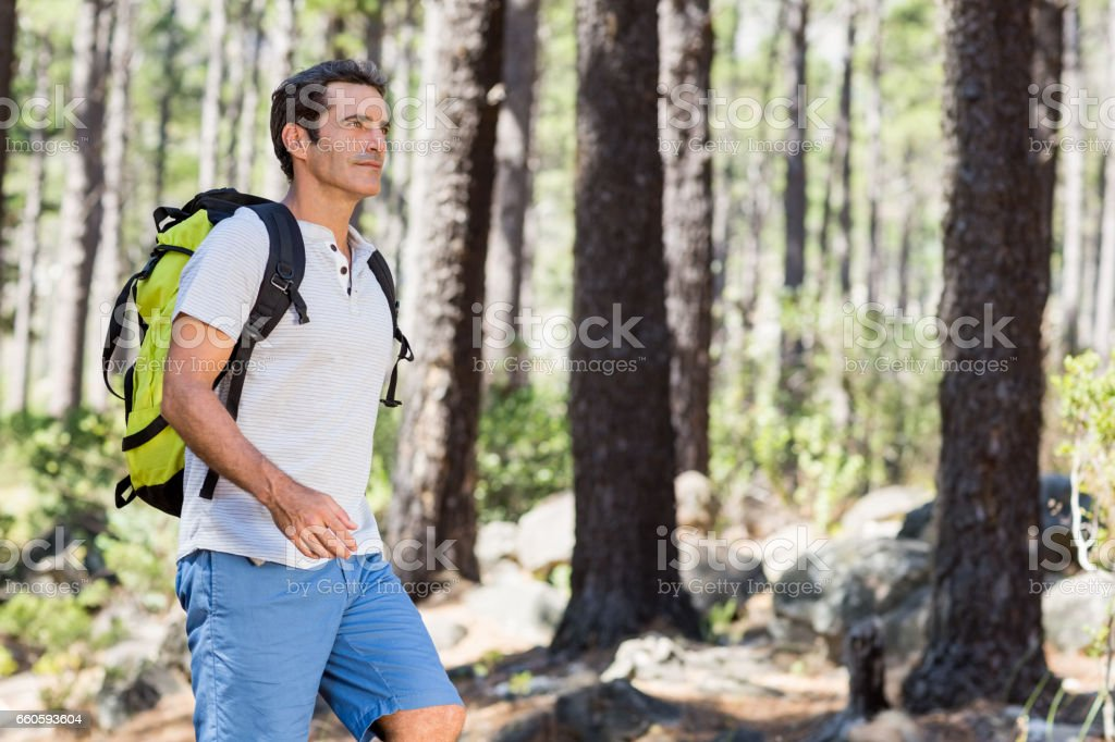 Side view of a man hiking royalty-free stock photo