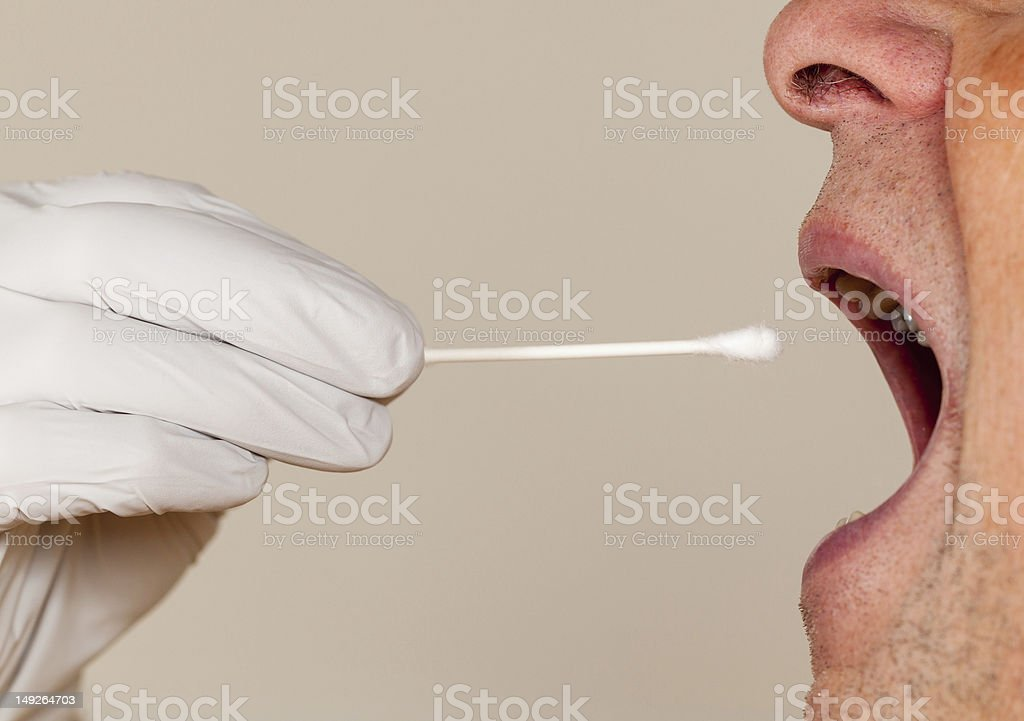 Side view of a mouth open for a DNA swab stock photo