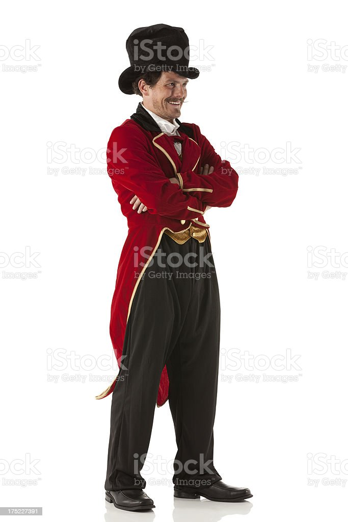 Side view of a ring master with arms crossed stock photo
