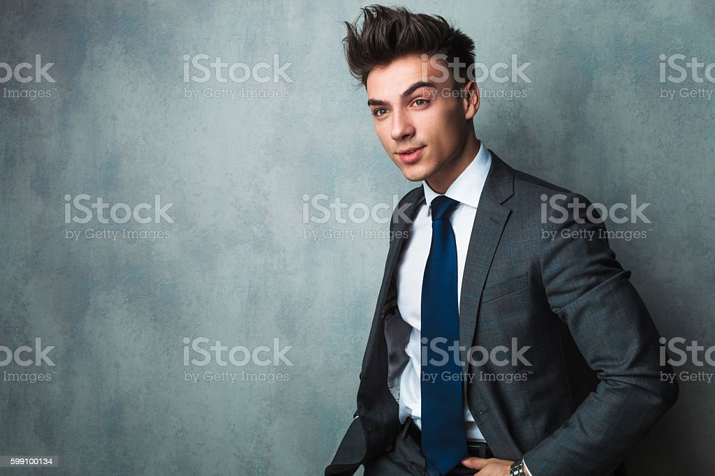 side view of a seated young businessman stock photo