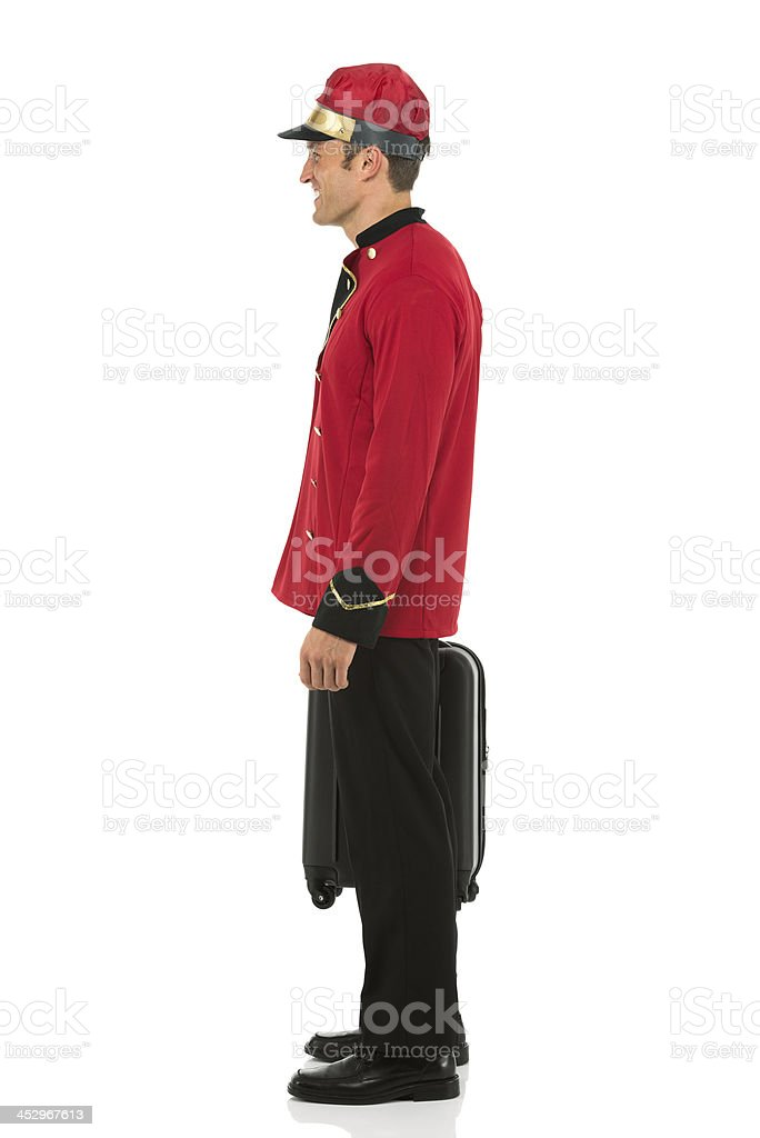 Side view of a valet holding suitcase royalty-free stock photo