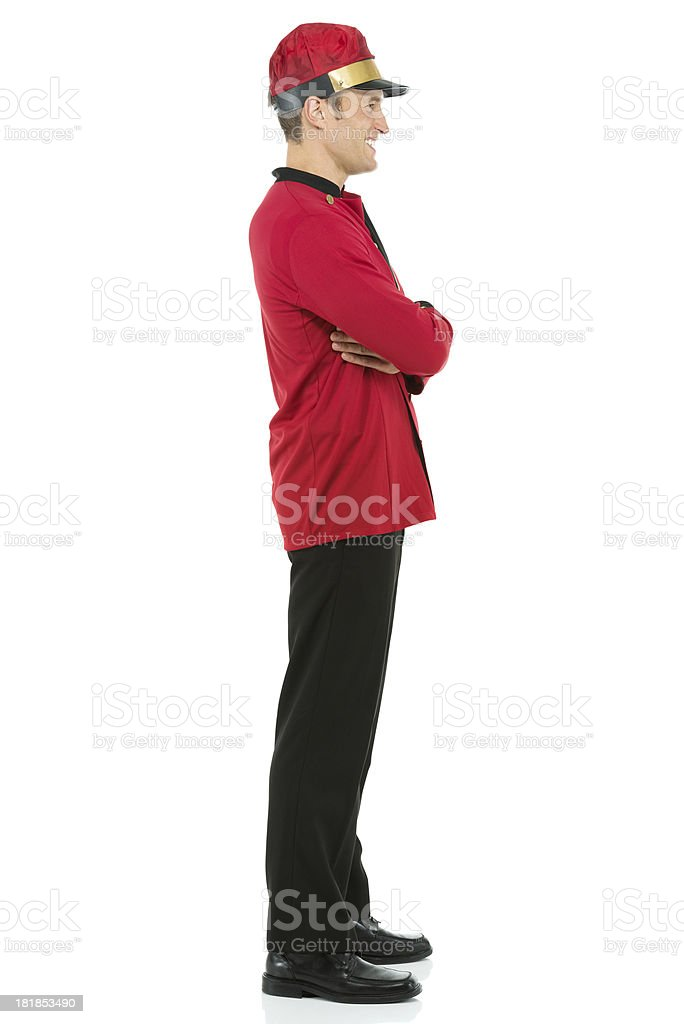 Side view of a valet with arms crossed royalty-free stock photo