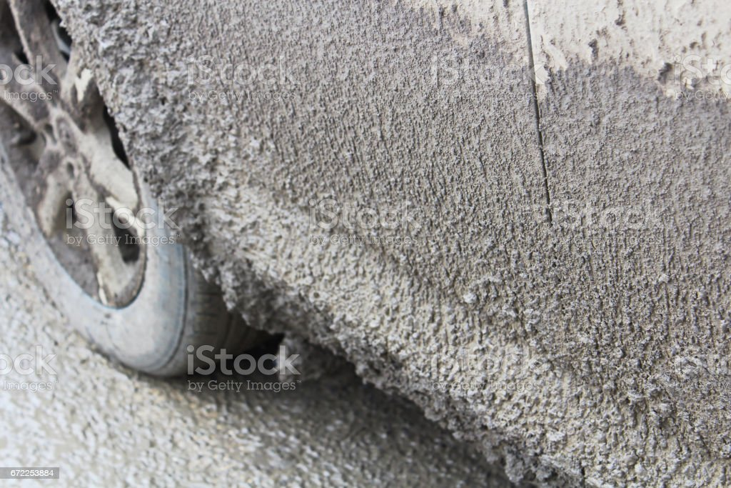Side view of a vehicle covered in thick mud stock photo