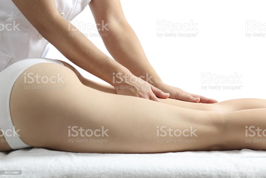 Side view of a woman legs receiving massage therapy stock photo