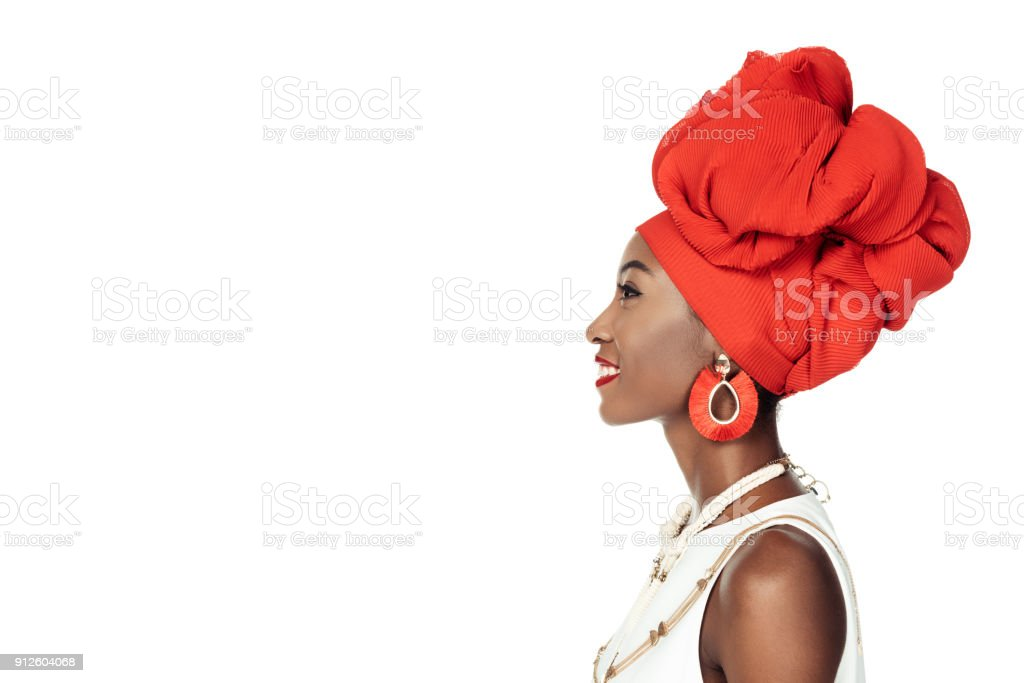 side view of african american woman in ethnic accessories  isolated on white stock photo